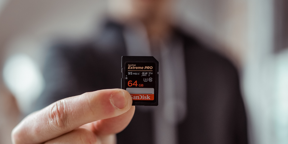 a man holding a memory card