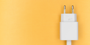 white power plug in a yellow backdrop