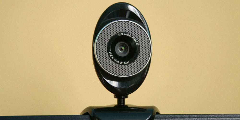 a webcam in a yellow wall background