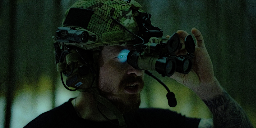 a man holding a night vision device