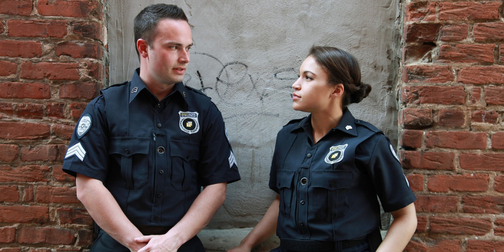 a man and woman police officer talking