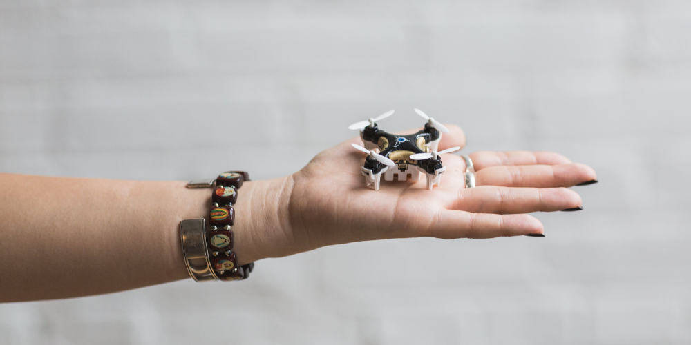 small drone a woman's palm